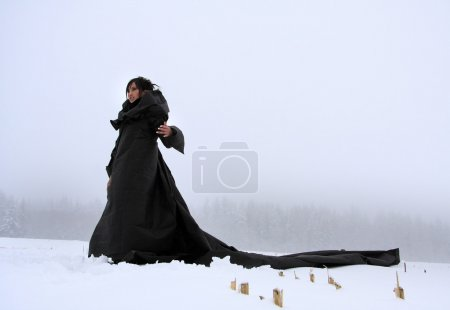 Mysterious girl in a long black dress