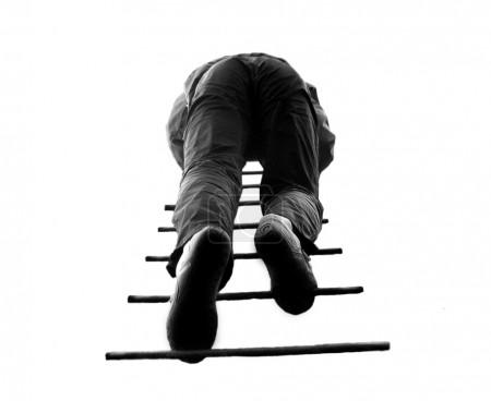 Man climbing a ladder, isolated on a whi