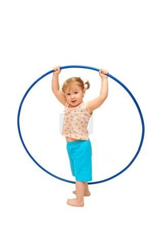 The little girl with a hoop