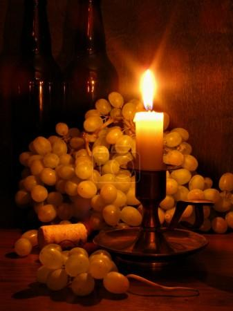 Grapes and candle