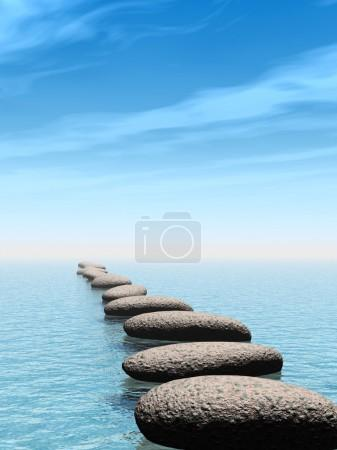 A row of stones in water