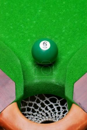 Green pool ball number 6