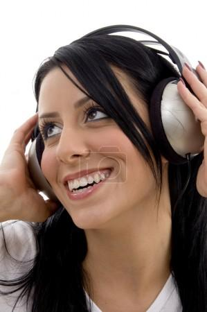 Cheerful young woman enjoying music
