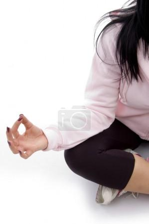 Half length view of female in lotus pose