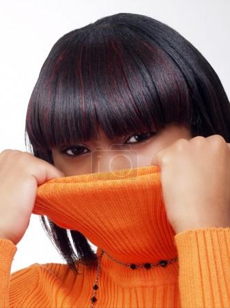 Young black woman pulling sweater