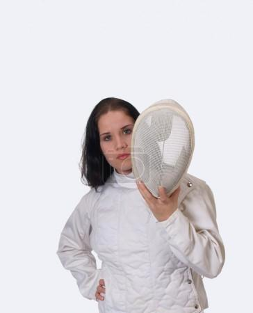 Young woman in fencing mask