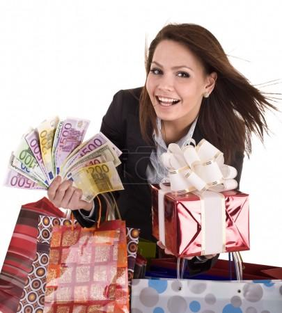 Business woman with money, gift box