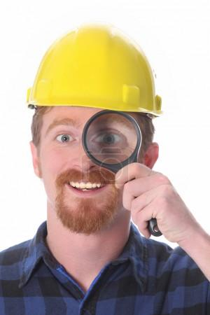 Construction worker with loupe