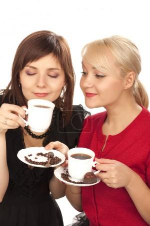 Two girls drinking coffee