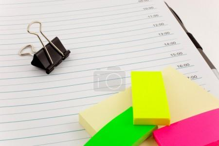 Organizer, post-its and steel clip