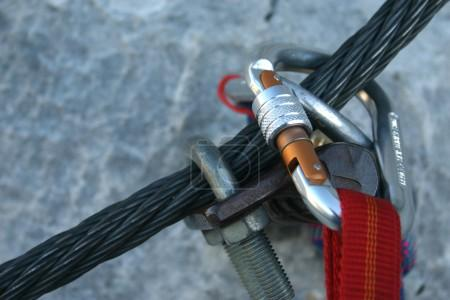 Climbing carabiner on a steel rope