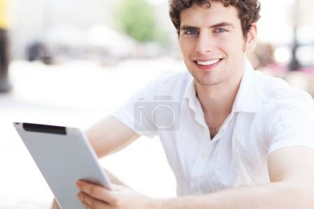 Young man with digital tablet