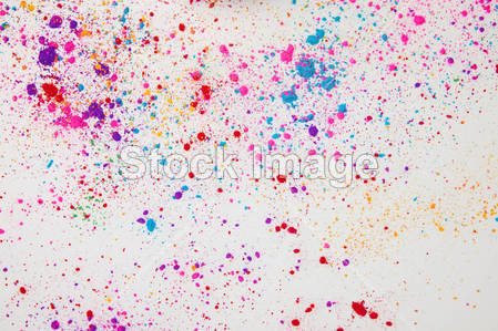 top view of scattered colorful holi powder isolated on white